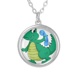 a crocodile with cell phone round pendant necklace