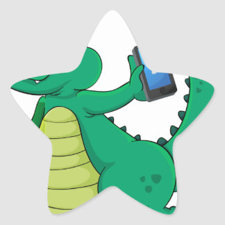 a crocodile with cell phone star sticker