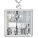A Crowd Admires a Pneumatic Clock Square Pendant Necklace