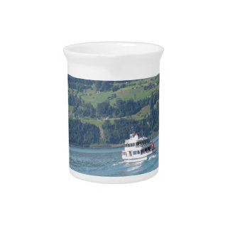 A cruise ship and beautiful scenery drink pitcher