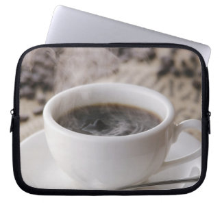 A cup of coffee computer sleeve
