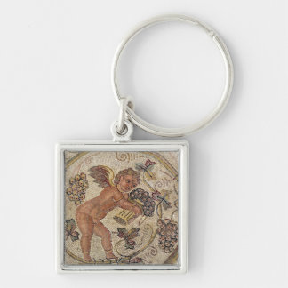 A cupid picking grapes, fragment of pavement keychain