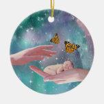 A cute baby boy in hand fantasy christmas tree ornaments