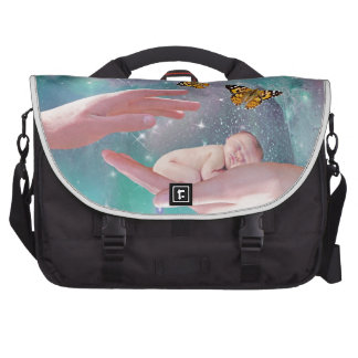 A cute baby in hand fantasy bags for laptop