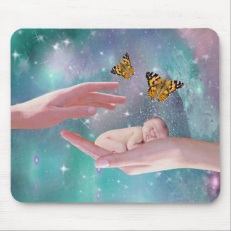 A cute baby in hand fantasy mouse pad