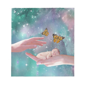 A cute baby in hand fantasy notepads