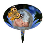 A cute baby lily butterfly bubble oval cake toppers