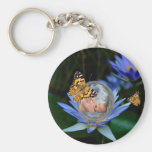 A cute baby lily butterfly bubble key chains