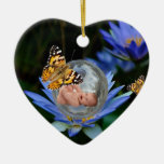 A cute baby lily butterfly bubble christmas ornament