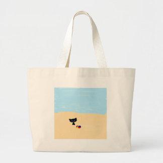 A Cute Black Cat Plays At The Beach Tote Bags