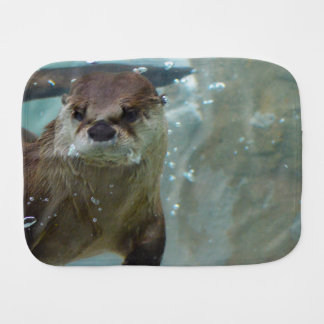 A cute Brown otter swimming in a clear blue pool Burp Cloth