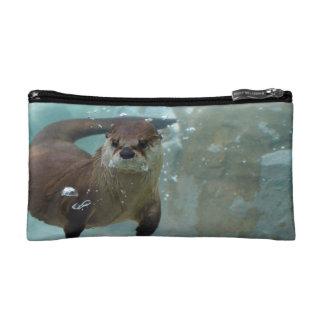 A cute Brown otter swimming in a clear blue pool Cosmetic Bag