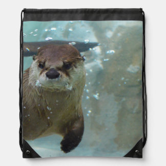 A cute Brown otter swimming in a clear blue pool Drawstring Bag