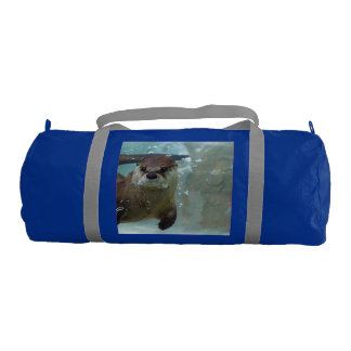 A cute Brown otter swimming in a clear blue pool Duffle Bag