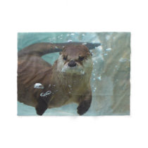 A cute Brown otter swimming in a clear blue pool Fleece Blanket
