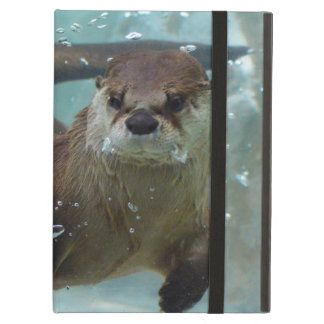 A cute Brown otter swimming in a clear blue pool iPad Air Case