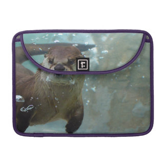 A cute Brown otter swimming in a clear blue pool MacBook Pro Sleeves
