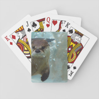 A cute Brown otter swimming in a clear blue pool Poker Cards