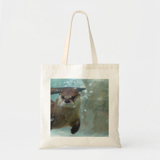 A cute Brown otter swimming in a clear blue pool Tote Bag