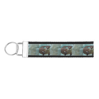 A cute Brown otter swimming in a clear blue pool Wrist Keychain