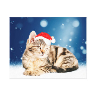 A Cute Cat wearing red Santa hat Christmas Snow Canvas Print