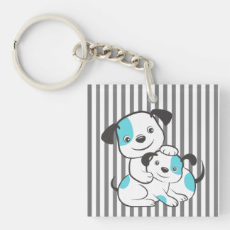 A cute dog playing with a puppy. keychain