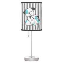 A cute dog playing with a puppy. table lamp