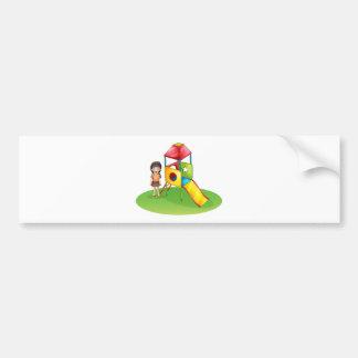 A cute girl at the playground car bumper sticker