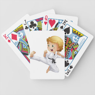 A cute little boy doing karate bicycle playing cards
