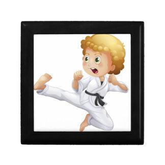 A cute little boy doing karate keepsake box