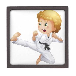 A cute little boy doing karate premium keepsake box