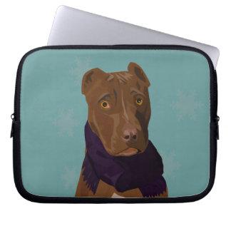 A cute sad dog face on a laptop sleeve