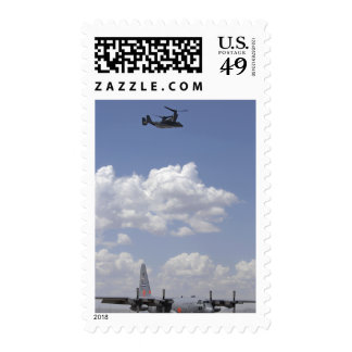 A CV-22 Osprey flies over a C-130 Hercules Postage Stamps