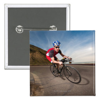 A cyclist leaning into a corner button
