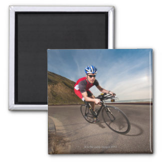 A cyclist leaning into a corner magnet