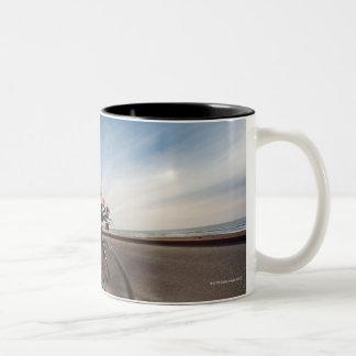 A cyclist leaning into a corner Two-Tone coffee mug