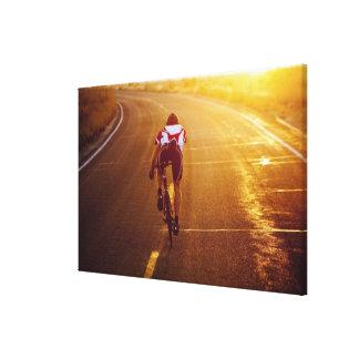 A cyclist on road bike near Great Salt Lake Stretched Canvas Print