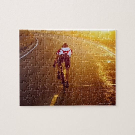 A cyclist on road bike near Great Salt Lake Jigsaw Puzzle