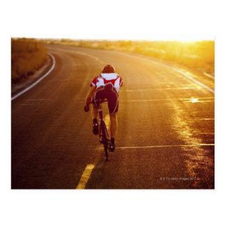A cyclist on road bike near Great Salt Lake Postcard