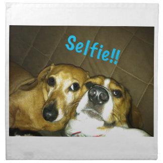A dachshund and a beagle taking a selfie napkin