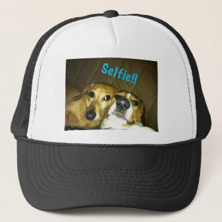 A dachshund and a beagle taking a selfie trucker hat