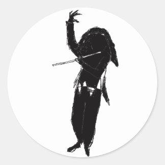 A Dark & Mystical Silhouette of a Flute Player Classic Round Sticker