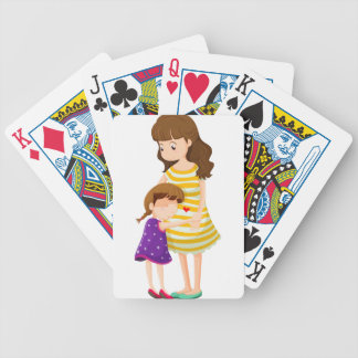 A daughter hugging her mother bicycle playing cards