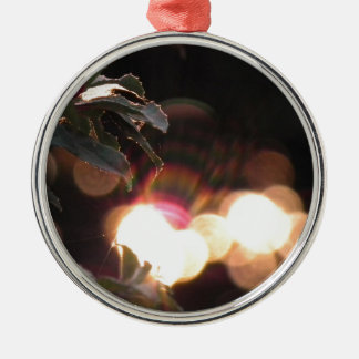 a  decorative mug, with artwork depicting a sunset metal ornament
