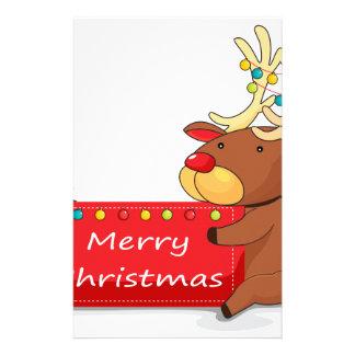 A deer holding a christmas card