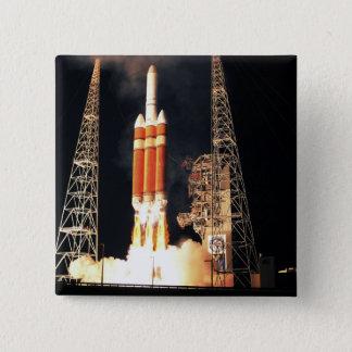 A Delta IV Heavy rocket lifts off Pinback Button