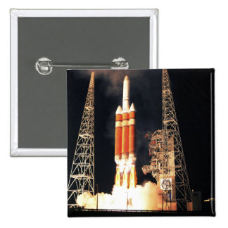 A Delta IV Heavy rocket lifts off Pinback Button