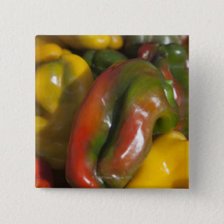 a display of colourful peppers for sale at the pinback button