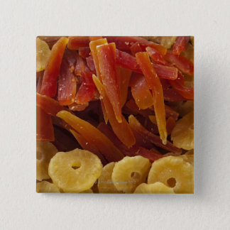 a display of preserved (candied) pineapple and pinback button