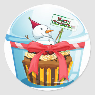 A disposable cup with a cupcake and a snowman insi classic round sticker